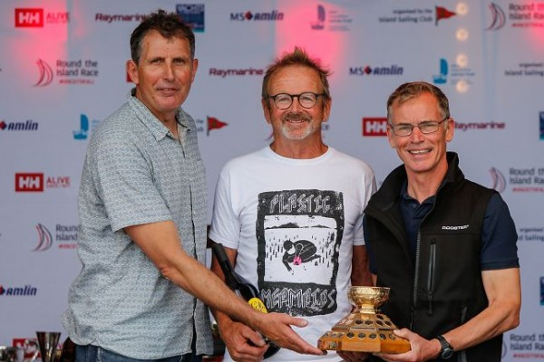 Jo Richards (center) and Duncan Deboltz (right) receive the Gold Roman Bowl from record breaking global sailor Brian Thompson – photo Paul Wyeth