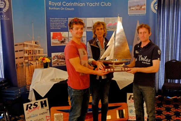 Annie Reid (RCYC Commodore) presents Ben Saxton (left) and Toby Lewis with the Endeavour Trophy