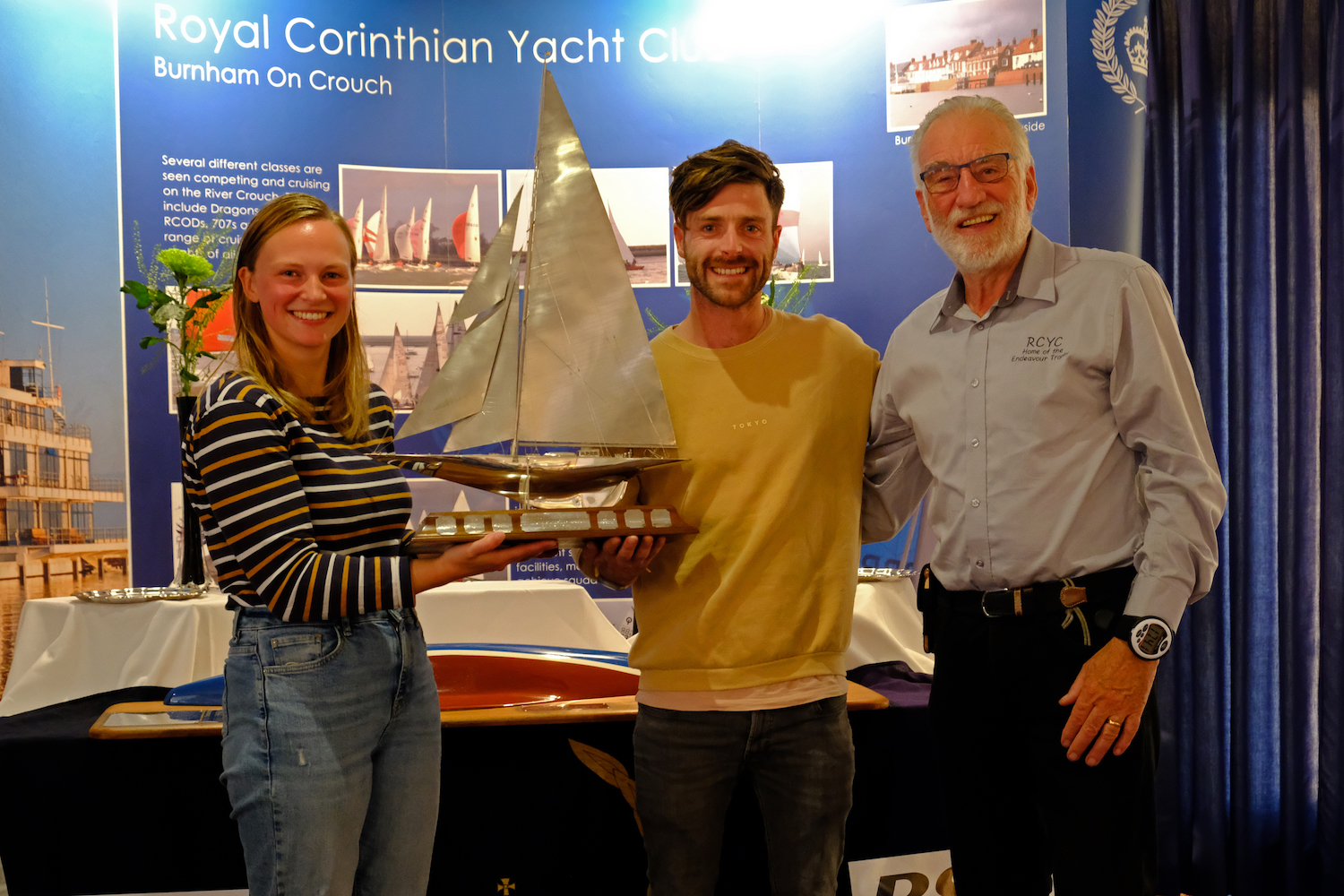 Edwin Buckley, race director, presents the solid silver Endeavour Trophy to Luke Patience and Mary Henderson – photo Roger Mant